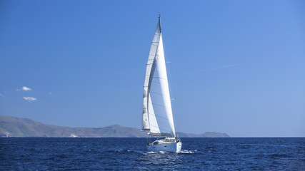 Sailboat participate in sailing regatta. Sailing. Luxury Yachts.