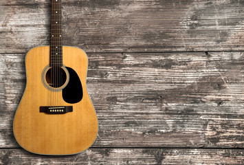 Acoustic guitar on wooden background