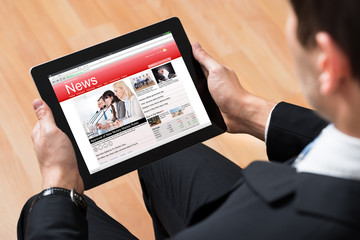 Businessperson Reading News Online