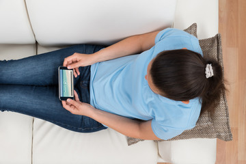 Woman Watching Video On Mobile Phone