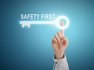 male hand pressing safety first key button
