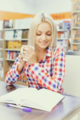 Girl reading books in library  for exam