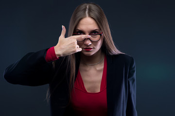 Portrait of woman fixing glasses