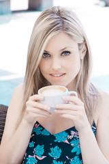 beautiful blond teen drinking coffee