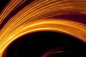 Flowing golden light streaks on black background