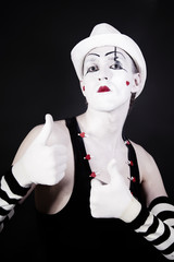 mime in makeup and  white hat