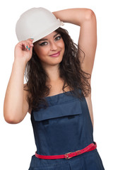Sexy girl in a deflated coverall and helmet on a white background