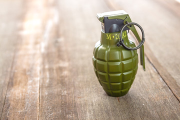 Hand grenade M26A1 model on wood background