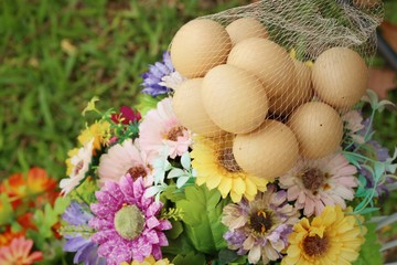 Eggs with beautiful flowers in a garden