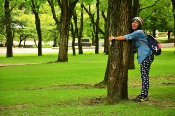 Thai women love and hug tree