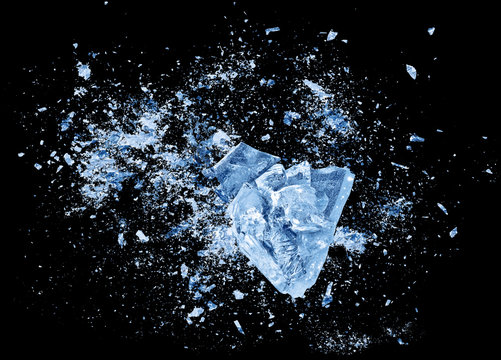 Abstract blue Ice crash explosion parts on black background. Collision, suspension crystal ice cubes damage.