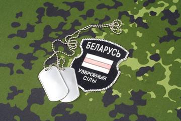 KIEV, UKRAINE - August, 06, 2015. Belarusian volunteers in Ukraine  Army. Russian-Ukraine war 2014 - 2015. Unofficial uniform badge with identification dog-tags