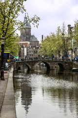 Canal and Cathedral church, Amsterdam, Netherlands