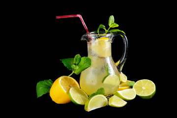 fresh lemonade with mint and lemon isolated on black background