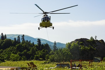 Passenger transport cargo helicopter flies