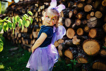 beautiful girl in a fairy costume with butterfly wings