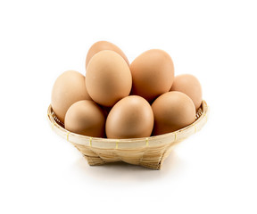 eggs of hen in basket isolate on white background