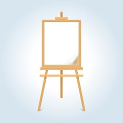 Wooden easel with blank paper sheet