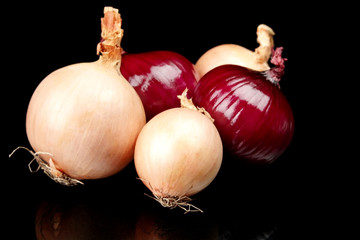 Onions and red onions isolated on black