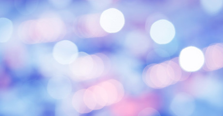 Abstract photo of backlight reflector and glitter bokeh lights background. Image is blurred and made with colorful filters.