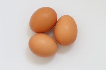 Three eggs isolated on white background. Brown eggs on white background.