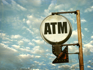 aged and worn vintage photo of atm sign