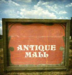 aged and worn vintage photo of hand painted antiques sign