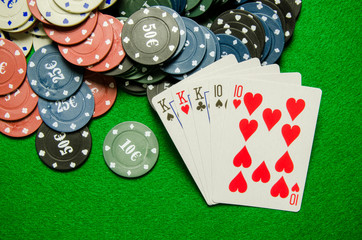 Playing cards 'Full House' and chips on green background