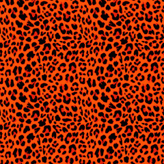 Leopard seamless pattern design in orange autumnal color, vector