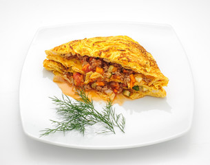 Omelette Thai style with vegetable filling isolated on white