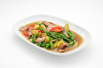 Pork stew with pineapple in sweet sauce isolated on white