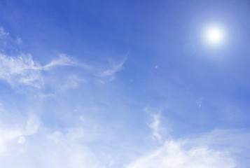 clouds and sun in the blue sky for background texture