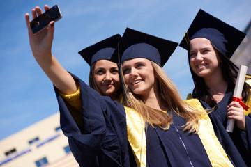 students group in graduates making selfie