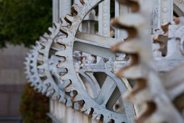 """Close-up of the cog wheels used to pull up the water gates at Geneva's """"Pont de la machine"""" which served for water level regulation and electricity production in the 19th and 20th centuries."""