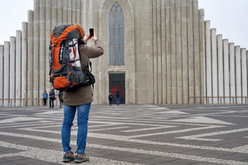 Long shot of backpacker woman in front of Cathedral