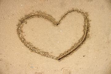 drawn heart shape on sand