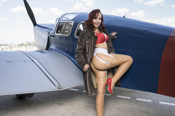 pilot, pinup dressed in era of the Second World War, beauty redh