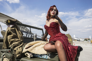 WWII, pinup dressed in era of the Second World War, beauty redhe