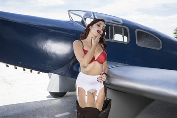 Sexy, pinup dressed in era of the Second World War, beauty redhe