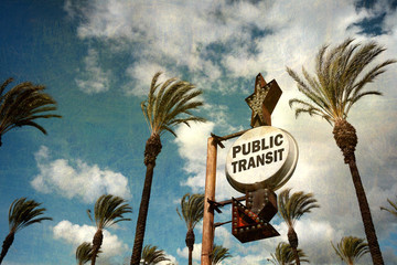 aged and worn vintage photo of public transit sign with palm trees