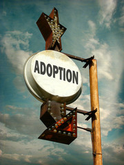 aged and worn vintage photo of adoption sign