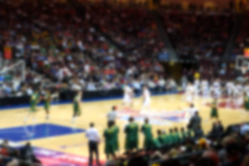 blurred background of basketball crowd in arena