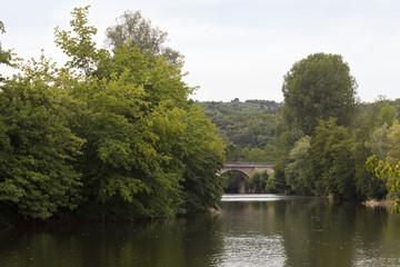 River La Vezere. The river La Vezere runs through a small fertile valley in the Dordogne region of France.