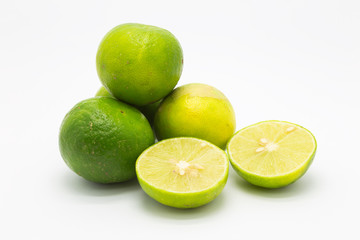 Fresh limes and slice on white background