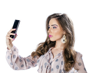 Young beautiful woman taking selfie with mobile phone