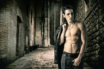 Young Vampire Man in an Open Black Leather Jacket, Showing Chest