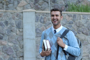 Happy handsome male student smiling - isolated at classic university entrance