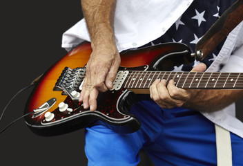 Man Playing and Electric Guitar