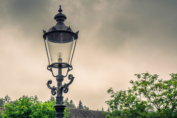Vintage street lamp in cloudy weather