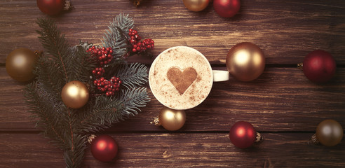 Cup of coffee with heart shape and christmas toys